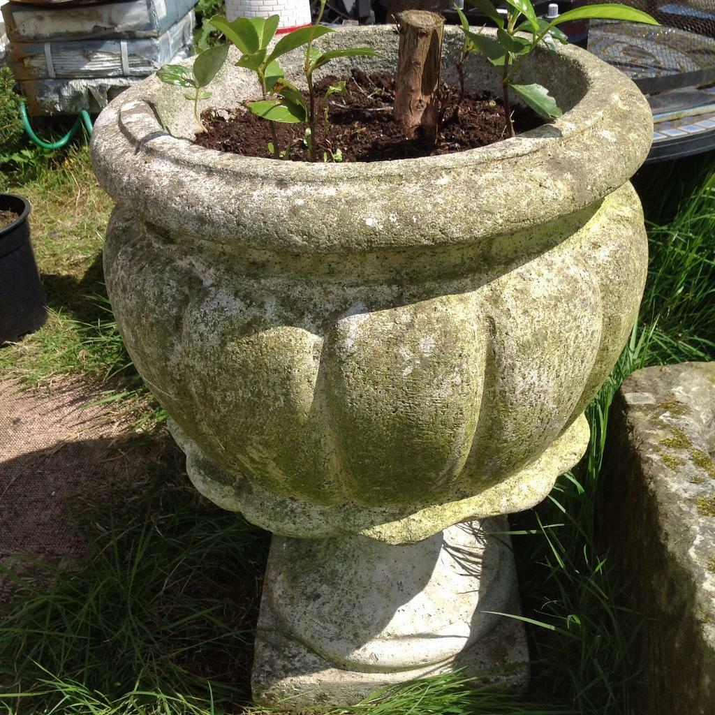 Two stone effect garden urns with detachable bases approx 24\