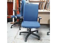 Konig + Neurath blue fabric operator chair with soft flat armrests