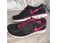 Black and pink nike flex trainers/shoes size 7