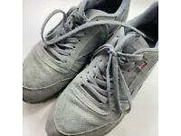 Grey suede Reebok trainers