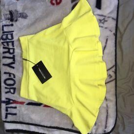 Pretty little thing verity lemon textured flippy hem mini skirt
