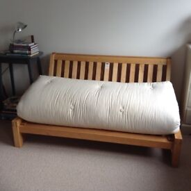 Futon Co.Sofa Bed . Good as new . Substantial Frame . Easy to store.