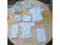 19 Motherease Onesize nappies, plus 3 booster pads, 15 soft fleece liners and 9 breathable liners