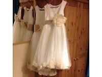 Two cream bridesmaid dresses