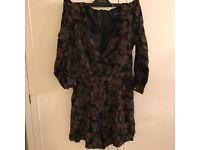 Will post. Like new. Size 8 River Island playsuit / jumpsuit. Zip back V front black floral