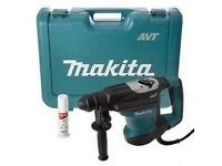 MAKITA HR3210C 110v 3 function hammer SDS + Drill for heavy-duty breaking and demolition work.