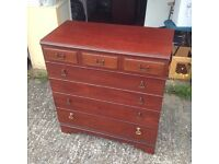 Solid wood chest of draws in mahogany finish for sale.