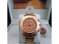 Gold Rolex Daytona , gold face, gold bezel. Comes Rolex Boxed with paperwork