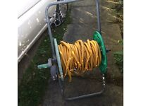 Large garden hose on trolly