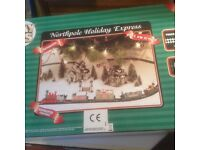Holiday Trains North Pole Express for Xmas Decor. Battery op.3M track with 5 pieces boxed near new.