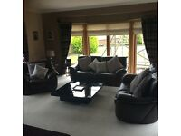 Large 2 seater,smaller 2 seater sofas,armchair,storage stool and black gloss storage coffee table