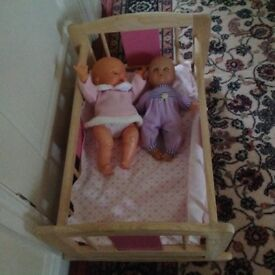 Pintoy dolls cot new cost £56 sell £15 comes with dolls and bedding can deliver call 07812980350