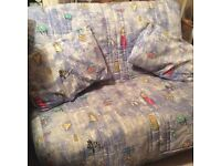 Double sofa bed. Quirky cartoon fabric. Great for child's bedroom