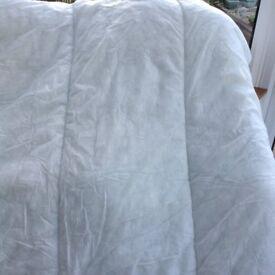 Single white duvet.