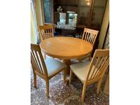 Pine round table 104cm wide 75cm high and 4 chairs excellent condition