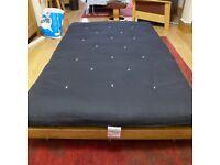 A Funky Futon small double pine futon bed.
