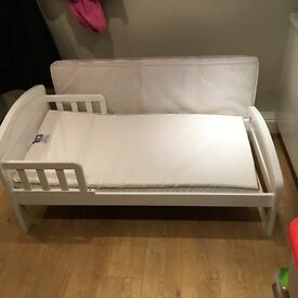 Child's first bed with two mattresses.