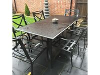 Black glass metal dining patio table No cushions free for collection