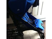 Joie blue stroller & buggy board brand new condition.