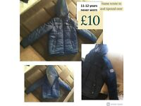 boys navy winter coat age 11-12 years purchased for school never worn