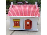 Traditional Wooden Doll's House, with furniture, accessories and figurines.