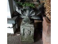 beautiful nicely weathered masonry urn on pedestal for garden or patio can deliver