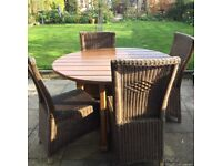 Solid wood garden table with rattan style chairs