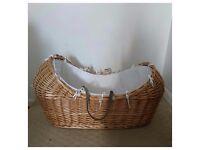 Moses basket - walnut wicker baby pod.
