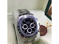 Silver Rolex Daytona with Black Face and Black Bezel Comes Rolex Bagged Boxed and with Paperwork