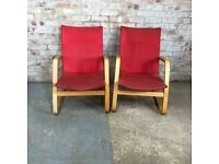 Pair of Retro Style Poang Red Woven Rocking Arm Chairs