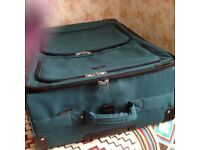 Large green suitcase 21.31.10ins wheels handle and outside pockets .MICROLITE TRAVELON VGC