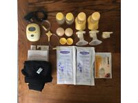 Medela Freestyle Double Electric Breast Pump with extra accessories.