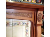 Antique Oak finish fireplace complete with Floral tiled hearth and back panel