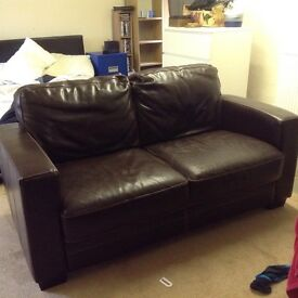 2 seater Brown leather sofa ex Furniture village still in fair condition