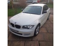 BMW 1 Series 118d white coupe.