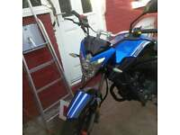 65 plate ZSA 125 in blue/black. great work horse with a little bit of speed
