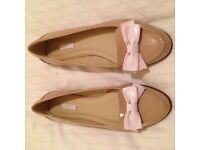 Brand new pretty NEXT flat patient shoes with bow. Size 6