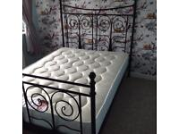 Black metal double bed frame.