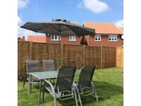 Family patio set 4 silver reclining chairs, parasol and stand