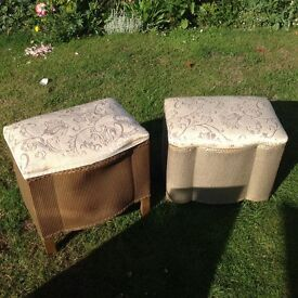 A pair of old ottomans