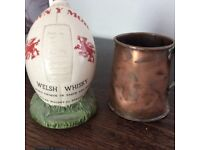 Old brass tankard and Welsh whisky flask