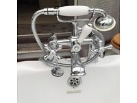 Beautiful free standing, roll top bath, cast iron feet and traditional taps