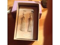 New silver earrings cost £35.00 on the box unwanted gift