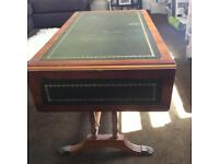 Vintage solid wood writing bureau with green leather detail and brass feet