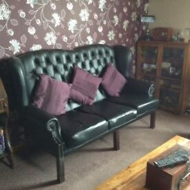 High backed faux leather Chesterfield style sofa