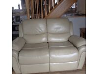 One cream leather recliner settee