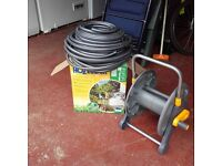 HoZelock Reel and Hosepipe (> 45m length) with all fittings for wall mounting. Unused.