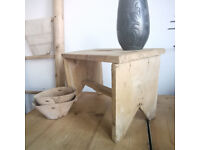 A very old restored milking stool, primitive, original 1900s, little table