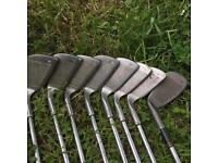 Golf clubs with retro Adidas golf bag