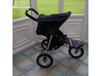 Black Our & About 3 wheeler stroller complete with a red and black cosy toes